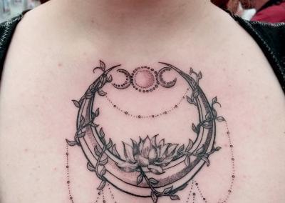 Moon lotus chest tattoo