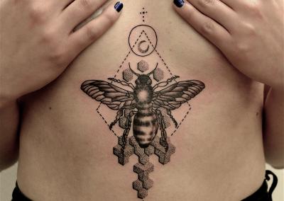 bee sacred geometry tattoo under boob