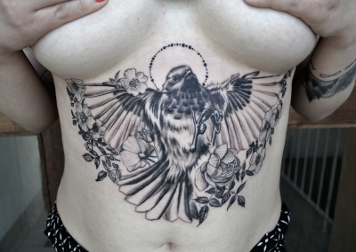 bird under boob pionee rib tattoo - Copy