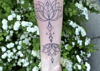 geometric lotus mandala arm tattoo