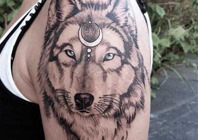 wolf woman symbol whipshade tattoo